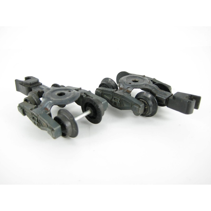 Two American Flyer Large Mounting Hole Trucks with Fixed Knuckle Couplers